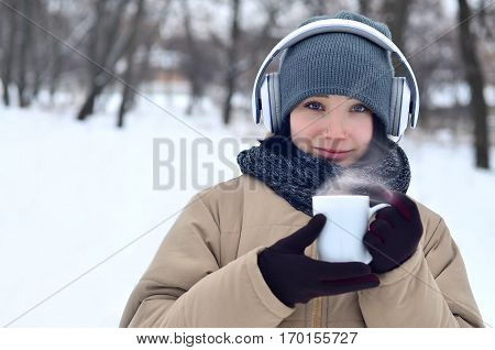Young Girl With Headphones And Coffee Cup