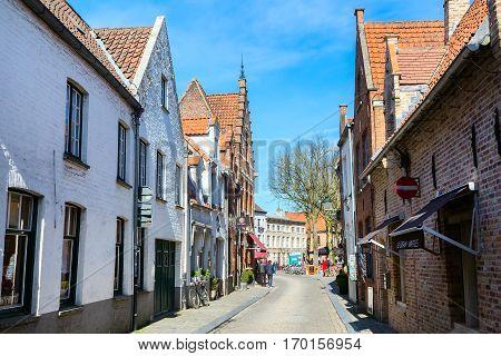 Bruges, Belgium - April 10, 2016: Street view with medieval traditional houses, bikes in popular belgian destination Bruges, Belguim