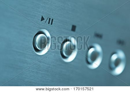 Buttons of a CD player in blue tone