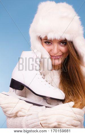 Woman Wearing Winter Hat Hugging Ice Skate