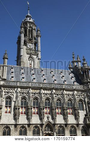 Old medieval townhall of Middelburg, with blue sky background, The Netherlands