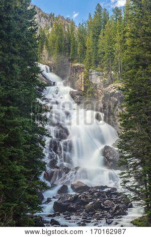 Beautifull Hidden Falls waterfall not far from Lake Jenny. Grand Teton National Park. Wyoming, USA