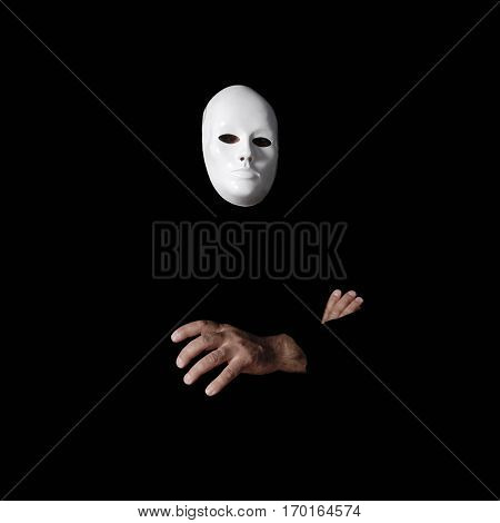 white mask and hands on black
