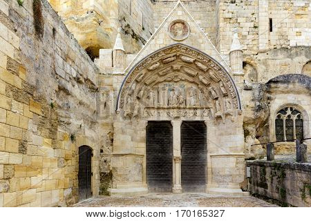 Entrance of old monolithic church in the Saint Emilion village near Bordeaux, France
