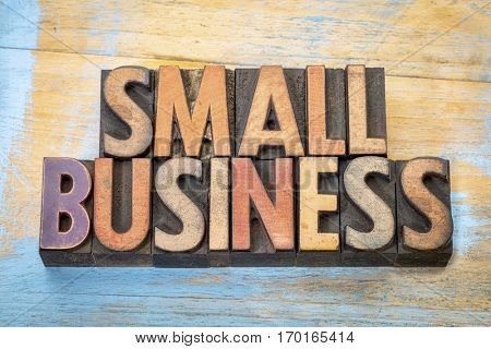 small business banner in vintage letterpress wood type blocks stained by color inks