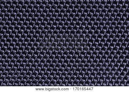 Deep blue fishnet cloth material as a texture background. Nylon texture pattern or nylon background for design with copy space for text or image.