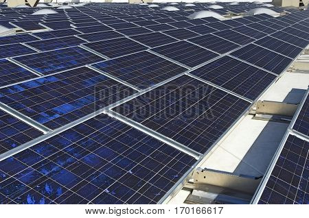 Solar Panels at solar power plant against clear sky