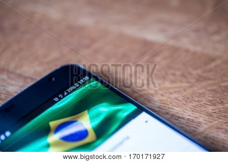 Smartphone With 25 Percent Charge And Brazil Flag