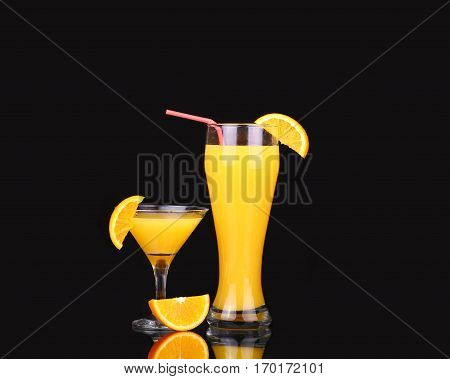 Fresh Organic Orange Juice And Vodka In A Tall Glass  On A Black Background