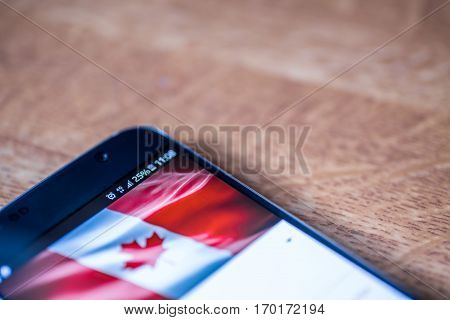 Smartphone With 25 Percent Charge And Canada Flag
