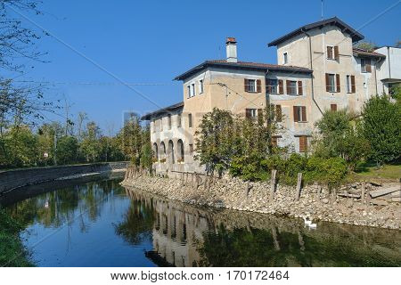 Country house along the Naviglio Grande of Turbigo (Milan Lombardy Italy) at fall with geese