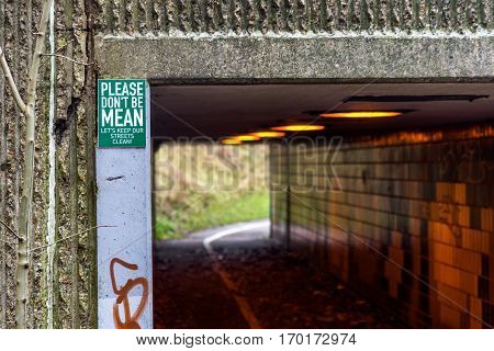 Pedestrian And Ciclyst Path Under Road With A Label Saying - Please Don't Be Mean. Let's Keep Our St