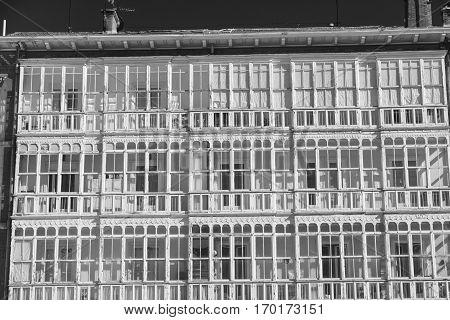Burgos (Castilla y Leon Spain): facade of historic building with balconies and verandas. Black and white