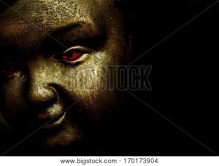 Close up angel face with red eyes and evil expression against black background