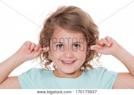 Young girl keeps her ears shut