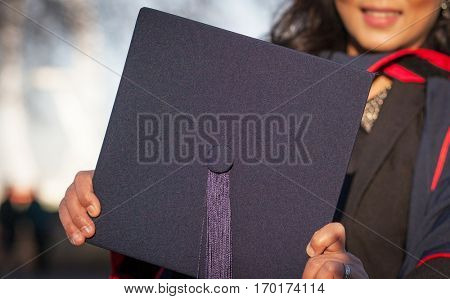 woman holding graduation cap