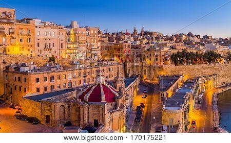 Valletta Malta - The traditional houses and walls of Valletta the capital city of Malta on an early summer morning before sunrise with clear blue sky