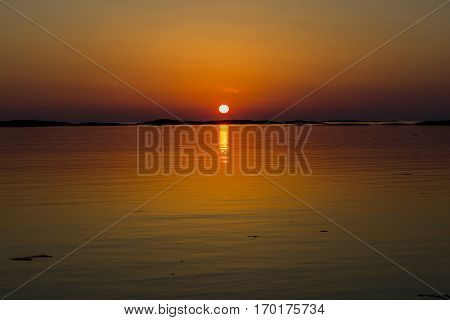 Orange toone Norwegian landscape in the midnight sun