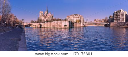 Picturesque panoramic view of Ile de la Cite, Seine River and Cathedral of Notre Dame de Paris in the winter morning, France