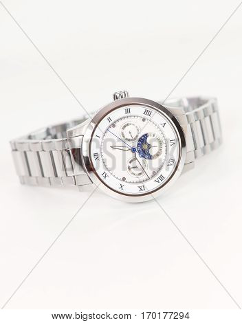 Silver wristwatch automatic with bracelet on white background