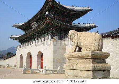 SEOUL - NOV 2, 2015: Main entrance in palace Gyeongbokgung with pagoda. Gate to royal palace of Gyeongbokgung is important symbol of Korean traditional culture