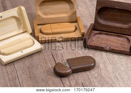 wooden usb flash drive on desk close up