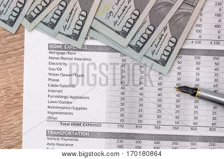 Income statement financial report with us dollar pen