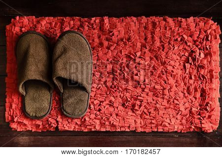 Red scraper brown comfort slipper on wood floor