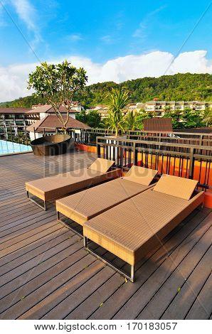 Rattan sunbeds at the poolside. Ao Nang, Krabi province, Thailand