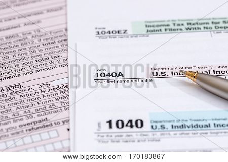 us tax form with pen close up