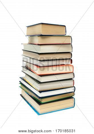 large stack of different books isolated on white background. vertical photo.
