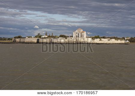 Gironde coastline with view on the village of Talmont sur Gironde and Sainte Radeguonde roman medieval church