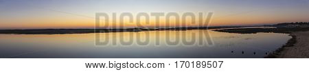 panoramic view of seaside landscape at sunset with reflection in still water over nature reserve Casse de la Belle Henriette, l'Aiguillon sur Mer,  Vendee, France