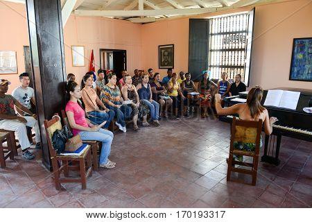 People Singing On A Choral At Santiago De Cuba