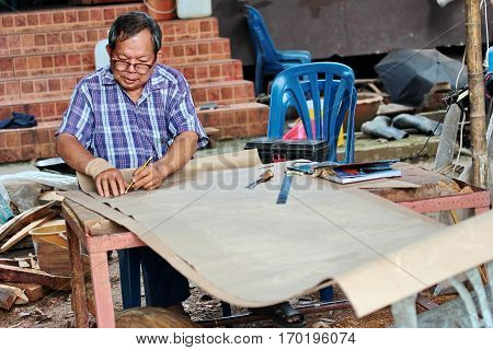Nan Thailand 8 Dec 2016 Folk artisan is drawing lines for use in its original carved wood from handmade to make the entrance hall of the temple is in the local community by using folk wisdom at Wat Rong Ngae Nan Thailand