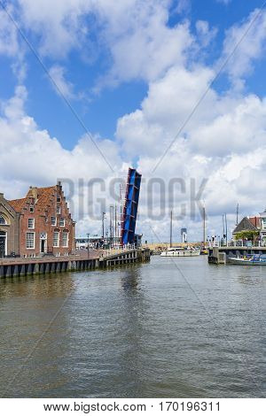 Noorderhaven canal with boats open bridge and houses in historic old town of Harlingen Friesland Netherlands