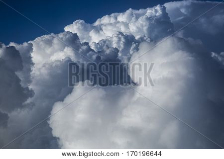 Close up on dark fluffy storm clouds