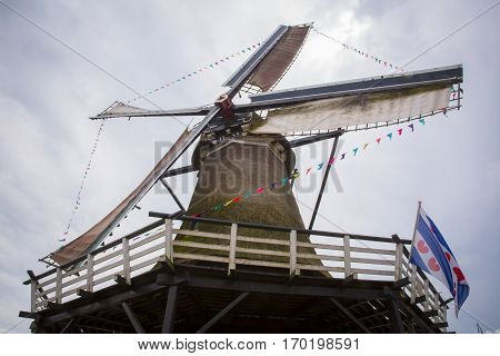 Typical old historical Dutch Windmill in use