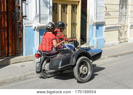 People Driving A Sidecar Bike At Santiago De Cuba