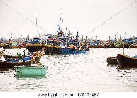 Mui Ne, Vietnam - February 7: Fishermen With Colorful Fishing Boats On February 7, 2012 In Mui Ne, V