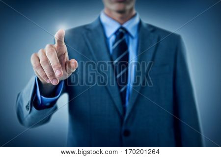 Well dressed businessman pointing against purple vignette