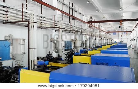 Row of CNC machines at empty workshop
