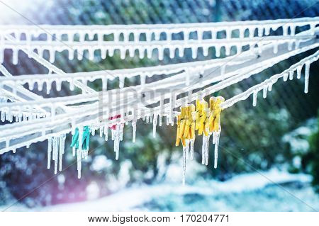 Icicles On Clothesline With Snow