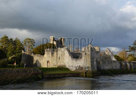 Scenic views of Desmond castle ruins in Ireland on River Maigue.
