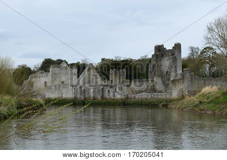 Desmond castle ruins with a river in County Limerick in Ireland.