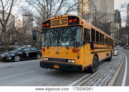 New York, February 6, 2017: An empty school bus is waiting parked on the East Drive of Central Park.