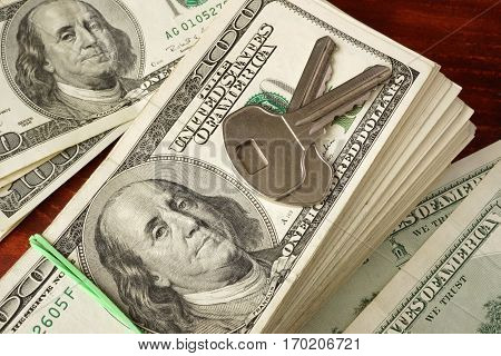 Pack of dollars and keys for apartments. Rent apartment concept.
