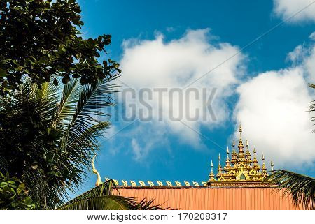Beautiful roof and a lot of great sky next to the Great Stupa in Vientiane, Laos