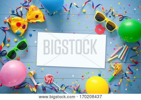 Colorful birthday frame with party items with copy space on blue background. Happy birthday concept