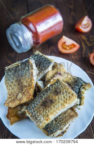 Pieces of mullet fish ready for frying.